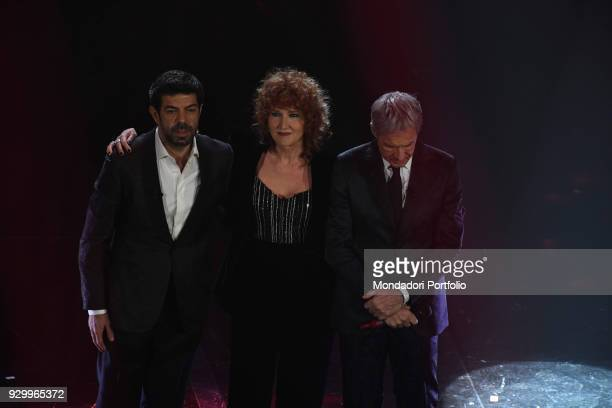Tv Host Claudio Baglioni and singer Fiorella Mannoia and Pierfrancesco Favino on stage at 68th Festival di Sanremo Sanremo February 8th 2018