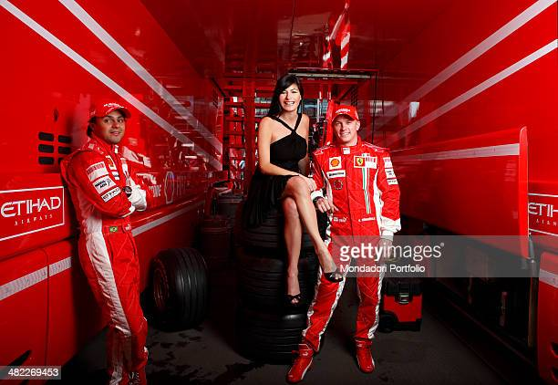 Tv host Ilaria D'Amico from Sky Sport and Formula One racing drivers Felipe Massa and Kimi Raikkonen posing in Ferrari's box Montmelo Spain April...