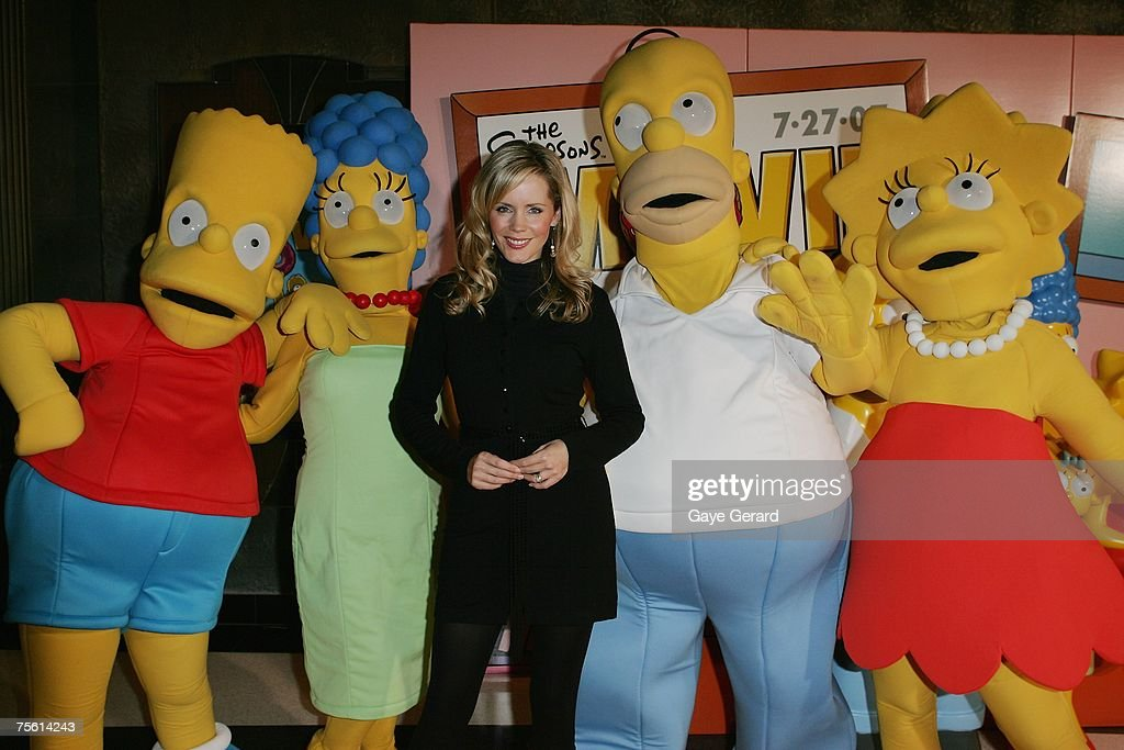 Tv Host Sophie Falkiner poses with the Simpson's on the yellow carpet at 'The Simpsons Movie' Australian premiere at Hoyts Entertainment Quarter, Moore Park on July 24, 2007 in Sydney, Australia.