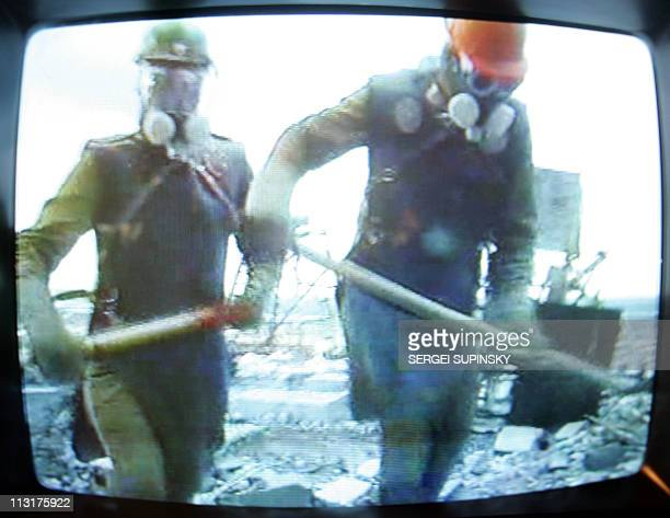 A tv monitor at Chernobyl's catastrophe museum in Kiev broadcasts 18 April 2006 a documentary film about the liquidators some 600000 front line...