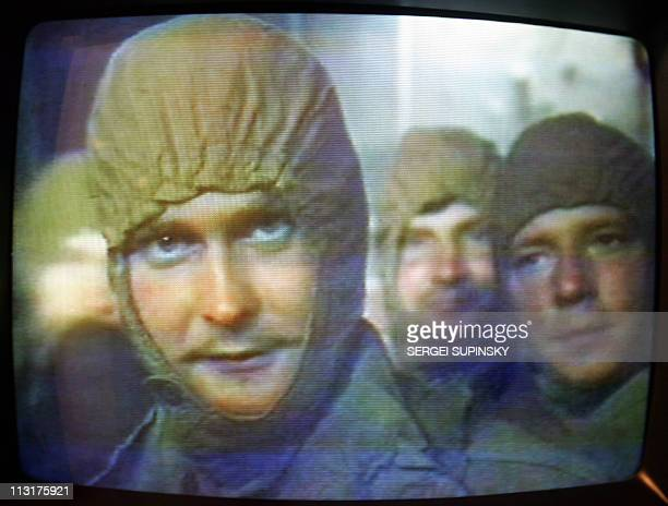A tv monitor at Chernobyl's catastrophe museum in Kiev plays 18 April 2006 a documentary film about liquidators some 600000 front line soldiers...