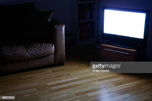a tv on in a living room - dusk dark stock photos and pictures