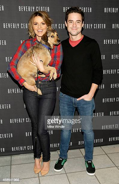 Tv personalities Ali Fedotowsky and Kevin Manno with their dog Owen attend the Beverly Center's Holiday Pet Portraits Debut on November 13 2014 in...