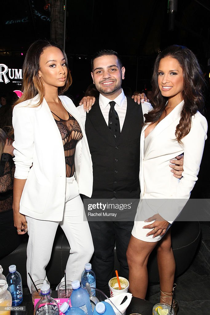 Tv personalities Draya Michele (L) and Rocsi Diaz (R) attend OK Magazine's So Sexy L.A. Event at LURE on May 21, 2014 in Los Angeles, California.