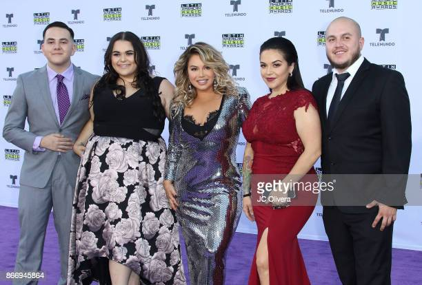 Tv personalities Johnny Lopez Jenicka Lopez Chiquis Rivera Jacqie Lopez Michael Marin of the reality tv show 'The Riveras' attend The 2017 Latin...