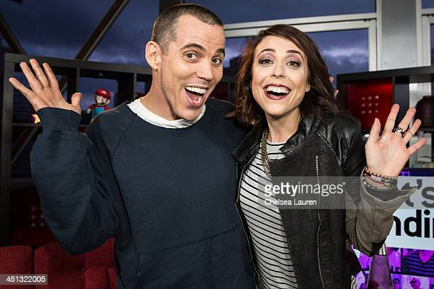 Tv personalities Steve-O and Shira Lazar visit 'What's Trending' on November 21, 2013 in Hollywood, California.