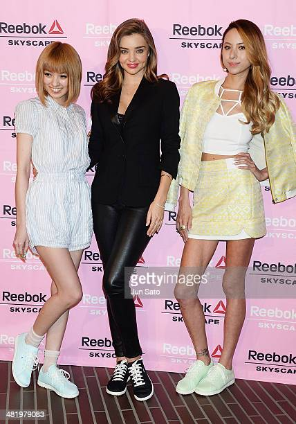 Tv personality Akina MInami models Miranda Kerr and Angelica Michibata attend the Reebok Skyscape party photocall on April 2 2014 in Tokyo Japan
