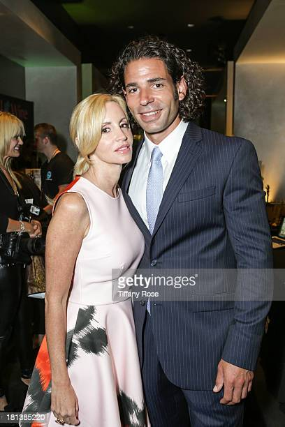 Tv Personality Camille Grammer and boyfriend Dimitri Charalambopoulos attend the GBK Productions Luxury Lounge during Emmy's Weekend on September 20...