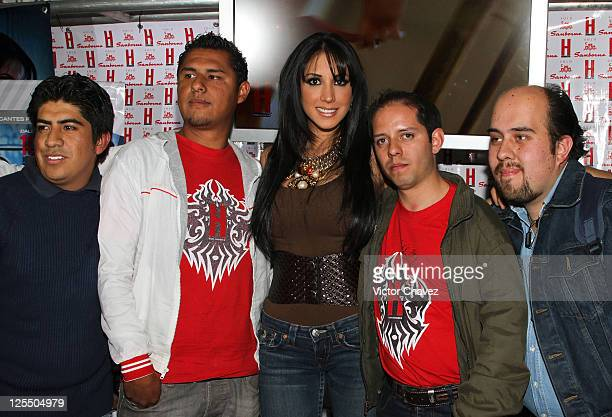 Tv personality Cynthia Urias and fans poses for photographers before she signs copies of her cover of H Para Hombres magazine at Pabellon Polanco on...