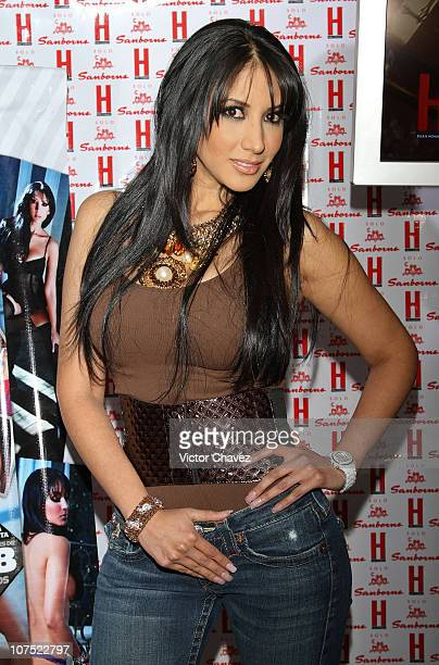 Tv personality Cynthia Urias poses for photographers before she signs copies of her cover of H Para Hombres magazine at Pabellon Polanco on December...