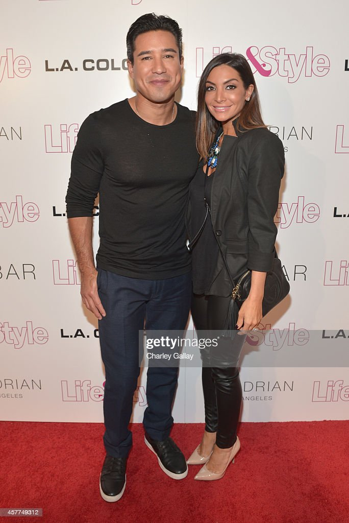 Tv Personality Mario Lopez (L) and wife Courtney Mazza attend Life & Style Weekly's 10 Year Anniversary party at SkyBar at the Mondrian Los Angeles on October 23, 2014 in West Hollywood, California.