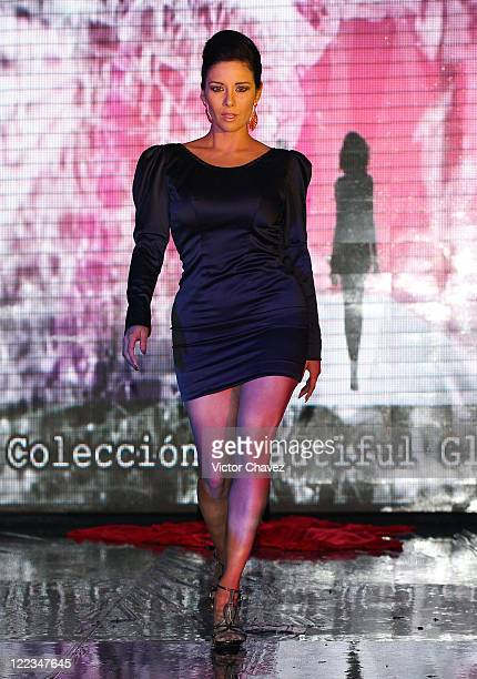 Tv personality Sugey Abrego walks the runway wearing Stivens Palacios Beautiful Glass 2010 collection at Casino Life on June 23 2010 in Mexico City...