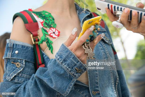 Tv presenter and DJ Yuri wears a Pinko dress Uniqlo jacket and Gucci bag and sparkly nails day 2 of Paris Haute Couture Fashion Week Autumn/Winter...