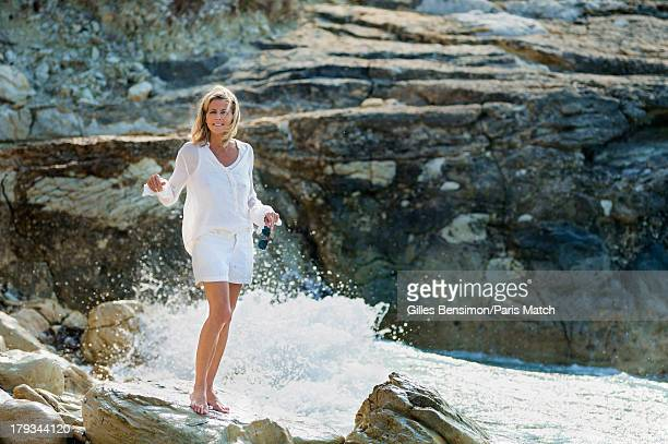 Tv presenter Claire Chazal is photographed on the Greek island of Paxos for Paris Match on August 16 2013 in Paxos Greece