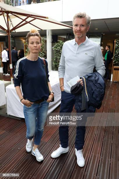 Tv presenter Denis Brogniart and his wife Hortense attend the 2018 French Open Day Three at Roland Garros on May 29 2018 in Paris France