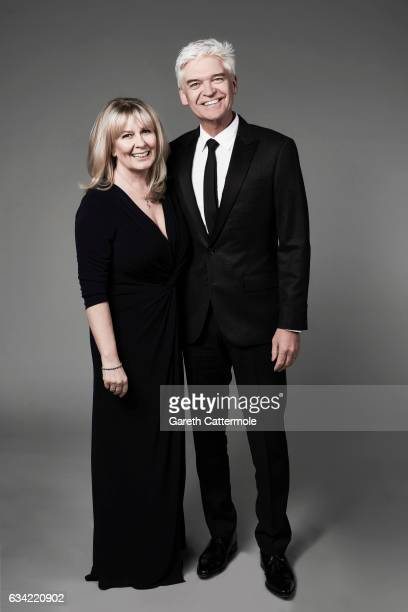 Tv presenter is Phillip Schofield is photographed with his wife Stephanie Lowe at the National Television Awards on January 25 2017 in London England