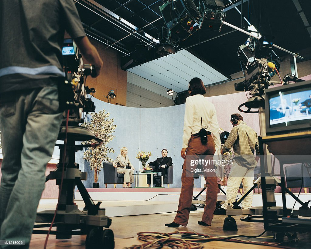 Tv Presenters in a Studio With a Producer and Cameramen : Stock Photo