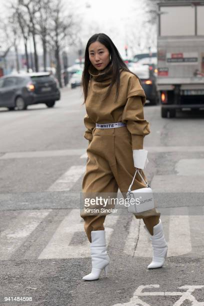 Tv producer Jamie Wu wears a Wanda Nylon jumpsuit and Off White belt bag and boots day 4 of Paris Womens Fashion Week Spring/Summer 2018 on March 1...