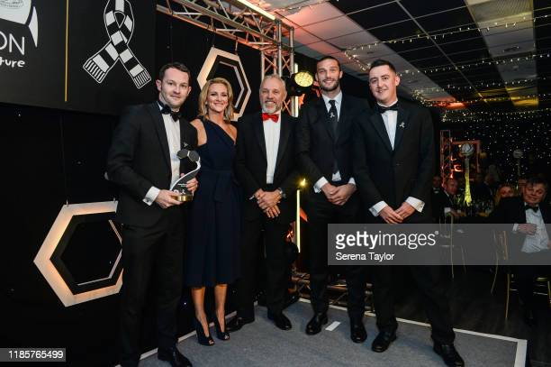 Tv Pundit Gabby Logan and Andy Carroll poses for a photo with United as one award winner John Harper during the Newcastle United Foundation's United...