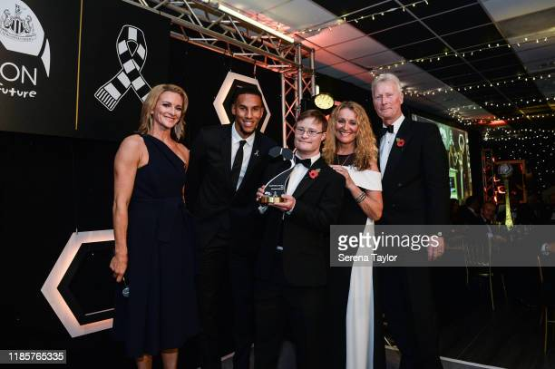 Tv Pundit Gabby Logan and Isaac Hayden pose for a photo with the Disabled Player of the year award winner Christopher McDonnell during the Newcastle...