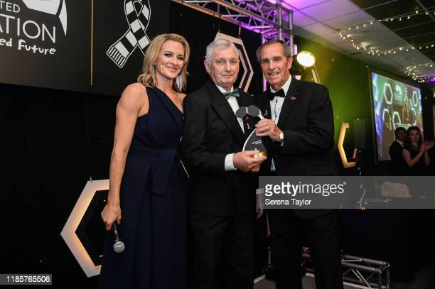 Tv Pundit Gabby Logan and Newcastle Legend Bob Moncur pose for a photo with David Craig as he is inducted into the Hall of Fame during the Newcastle...