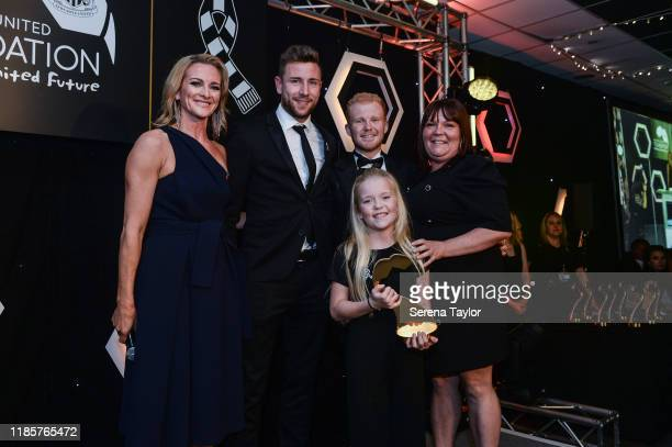 Tv Pundit Gabby Logan and Paul Dummett poses for a photo with the Helen McCardle Young Achiever Award Winner Tilly Stewart during the Newcastle...