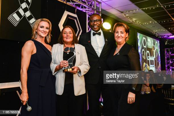 Tv Pundit Gabby Logan and Shola Ameobi pose for a photo with Alder Sweeney Community Impact Award winner Lisa Bell during the Newcastle United...