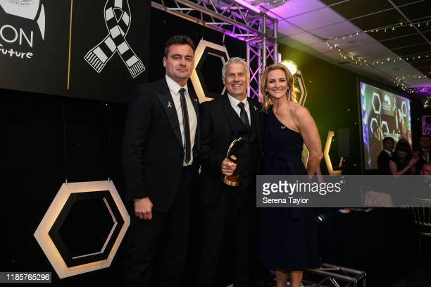 Tv Pundit Gabby Logan poses for a photo with Ex Newcastle Goalkeeper Steve Harper and Rob Lee as Rob is inducted into the Hall of Fame during the...