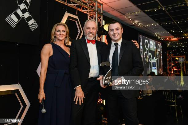 Tv Pundit Gabby Logan poses for a photo with United as one Highly Commended award winner Les Peacock during the Newcastle United Foundation's United...