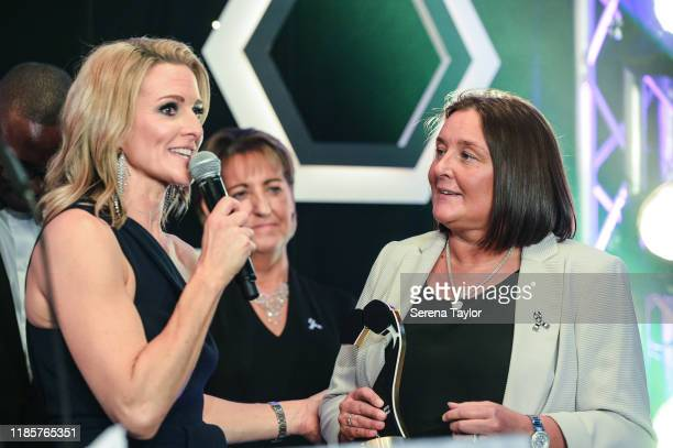 Tv Pundit Gabby Logan speaks with Alder Sweeney Community Impact Award winner Lisa Bell during the Newcastle United Foundation's United as One annual...