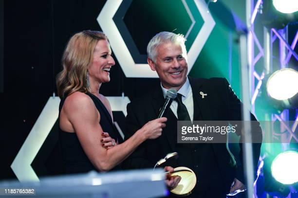 Tv Pundit Gabby Logan speaks with Rob Lee as he is inducted into the Hall of Fame during the Newcastle United Foundation's United as One annual...