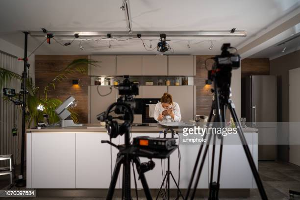 tv set studio kitchen female cook preparing cookies - film studio stock pictures, royalty-free photos & images