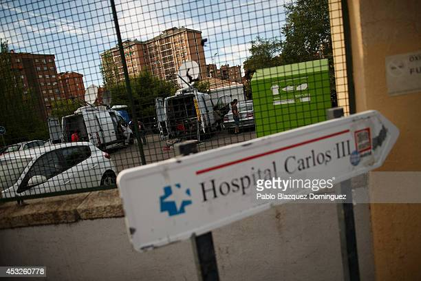 Tv stations are parked at Carlos III Hospital before the arrival of Priest Miguel Pajares on August 6 2014 in Madrid Spain Priest Miguel Pajares 75...