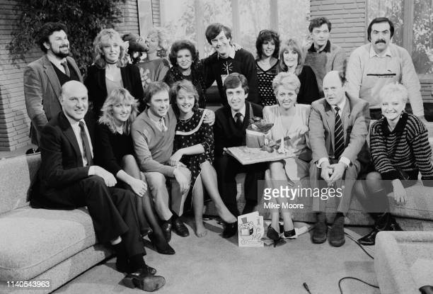 TVam broadcasters posing for a group photo UK 1st February 1984 including Anne Diamond and Nick Owen Back row includes Eve Pollard Roland Rat Gyles...