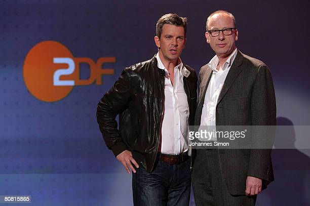 TVhost Markus Lanz and ZDF editor in chief Manfred Teubner pose prior to a press conference with German actor Karlheinz Boehm at Bavaria Film...