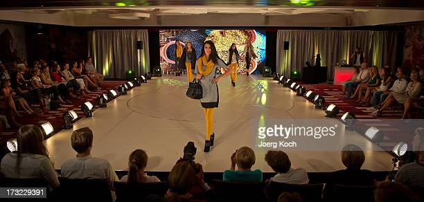 TVhost RebeccaZarah Mir and professional models pose at the Ernsting's Family Fashion Show Fall/Winter 2013 at Hotel Vier Jahreszeiten on July 10...