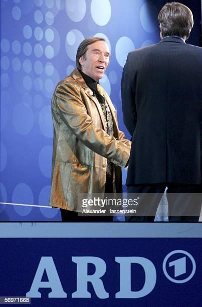 Moderator Guenter Netzer seen in the golden jacket of TV presenter Thomas Gottschalk during the international friendly match between Italy and...