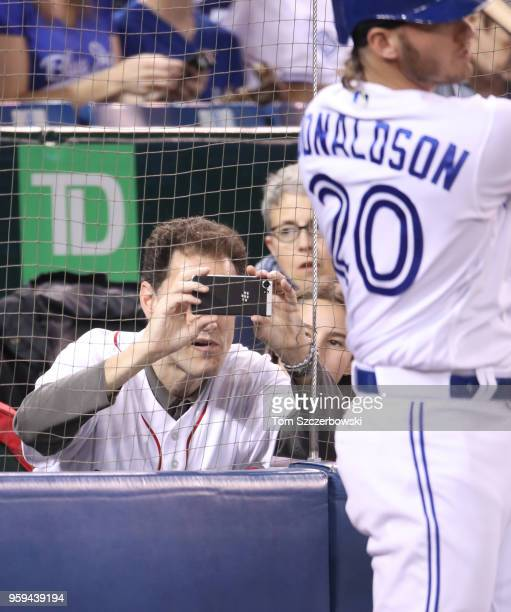 TVOntario anchor Steve Paikin takes a picture of Josh Donaldson of the Toronto Blue Jays as he gets ready to bat from the ondeck circle in the first...