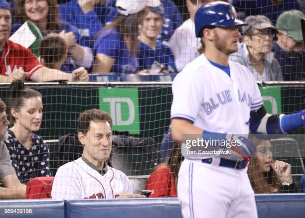 TVOntario anchor Steve Paikin watches as Josh Donaldson of the Toronto Blue Jays gets ready to bat from the ondeck circle in the first inning during...