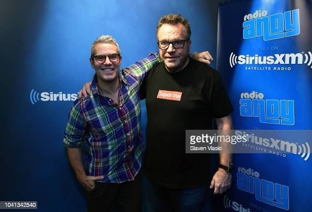 Radio personality Andy Cohen and actor Tom Arnold pose for photos at Radio Andy at SiriusXM Studios on September 26, 2018 in New York City.