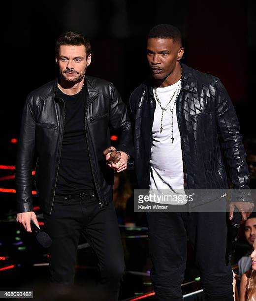 TV/radio personality Ryan Seacrest and host Jamie Foxx speak onstage during the 2015 iHeartRadio Music Awards which broadcasted live on NBC from The...