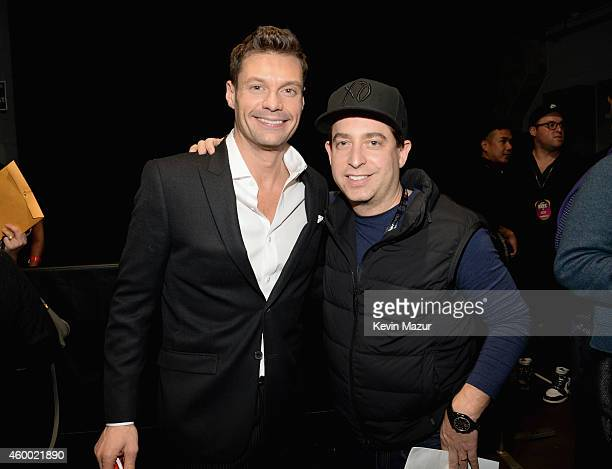 Radio personality Ryan Seacrest and Republic Records EVP Charlie Walk attend KIIS FM's Jingle Ball 2014 powered by LINE at Staples Center on December...