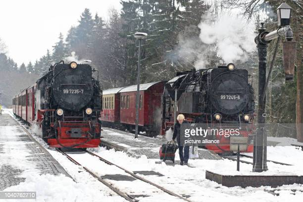 Tw trains of the Harz regional railway HSB departs the railway station DreiAnnenHohne in the direction of Schierke Germany 01 March 2017 Thanks to...