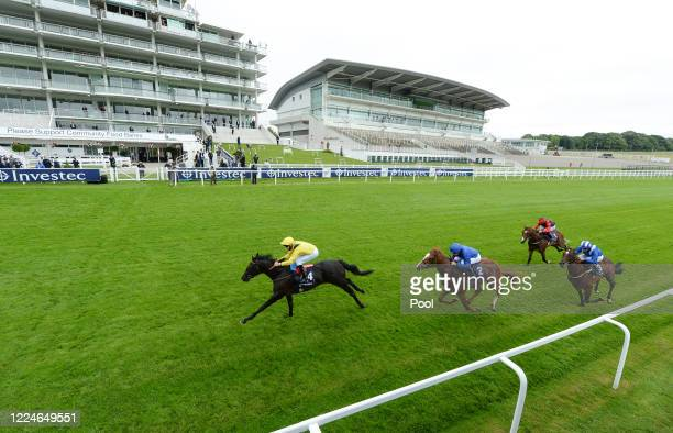 Twaasol and jockey Martin Harley wins the Investec Woodcote EBF Stakes at Epsom Racecourse on July 04, 2020 in Epsom, England. The famous race...