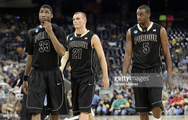 E'Twaun Moore DJ Byrd and Keaton Grant of the Purdue Boilermakers during a 7057 loss against the Duke Blue Devils during the south regional semifinal...