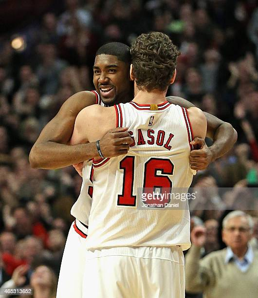 Twaun Moore of the Chicago Bulls gets a hug from teammate Pau Gasol after hitting the gamewinning three point shot against the Oklahoma City Thunder...