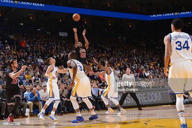 E'twaun Moore of the Chicago Bulls shoots a three pointer against the Golden State Warriors on November 20 2015 at Oracle Arena in Oakland California...