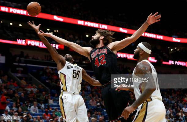 Twaun Moore of the New Orleans Pelicans out rebounds Robin Lopez of the Chicago Bulls during the first half of a NBA game at Smoothie King Center on...