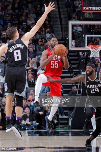 Twaun Moore of the New Orleans Pelicans puts up a shot against Bogdan Bogdanovic of the Sacramento Kings on March 7 2018 at Golden 1 Center in...