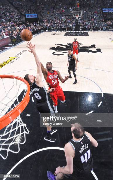 Twaun Moore of the New Orleans Pelicans shoots against Bogdan Bogdanovic of the Sacramento Kings on March 7 2018 at Golden 1 Center in Sacramento...
